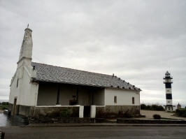 Church and lighthouse in Ortiguera